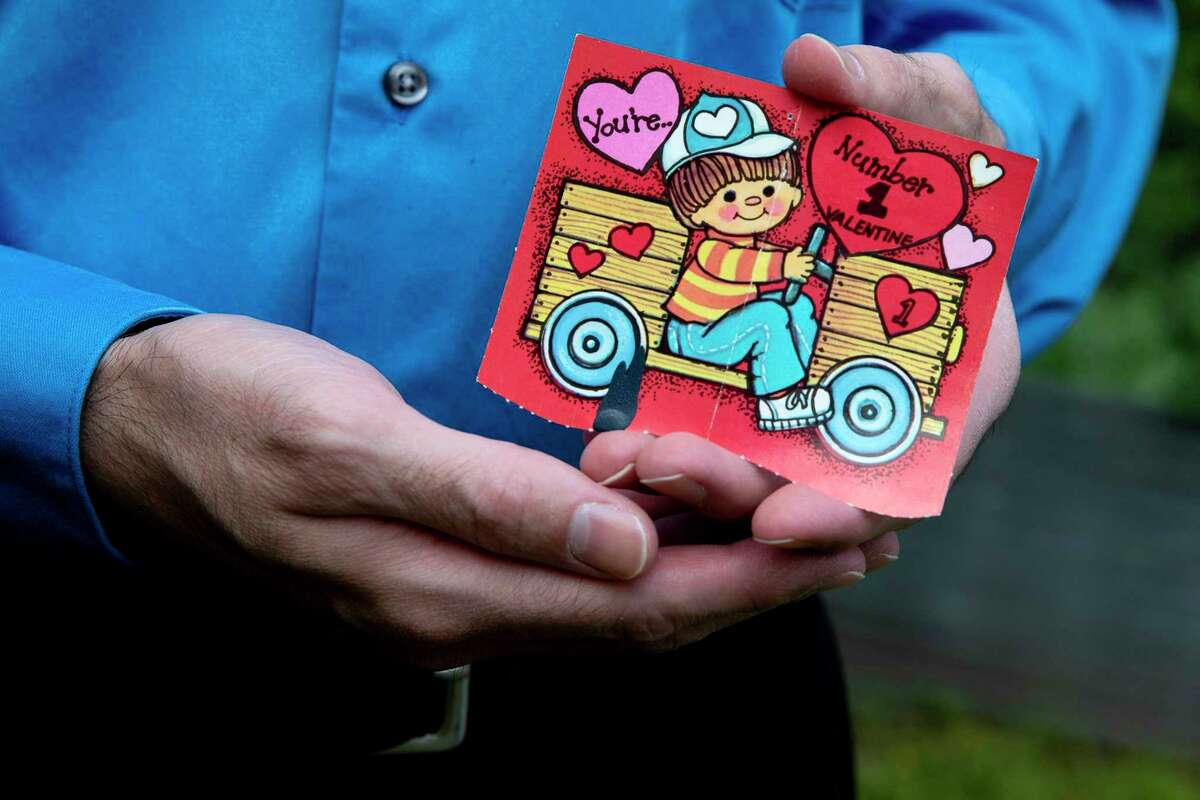 Christopher Palmer cherishes a Valentine's Day given to him by his childhood friend Jennifer Sue Delgado, who was fatally stabbed in 1988 when she was 8 years old.