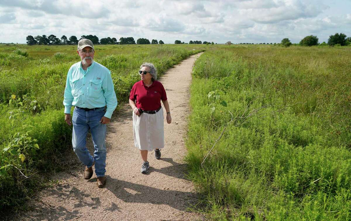 Wesley Newman, Katy Prairie Conservancy conservation director, left, and Mary Anne Piacentini, Katy Prairie Conservancy president, right, talk about at the Indiangrass Preserve, 31975 Hebert Road, Tuesday, July 20, 2021 in Waller. The Katy Prairie Conservancy is pursuing a green cemetery. They haven't picked a location yet but say the Indiangrass Preserve is a good example of what it will look like.