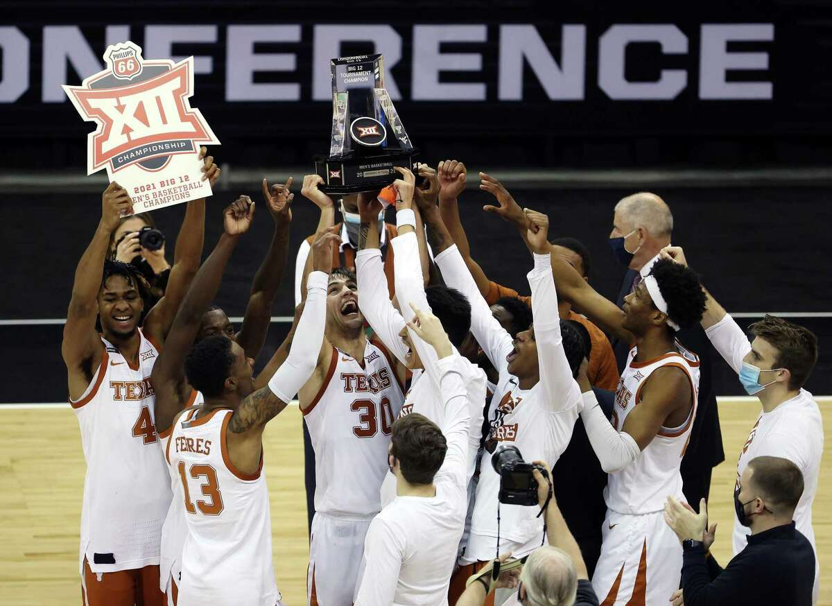 The Texas Longhorns celebrate after winning the Big 12 Tournament championship game in March. Teports that the University of Texas and the University of Oklahoma are preparing to exit the Big 12 in a bid to join the SEC has spurred a group of lawmakers to file legislation seeking to block the move.