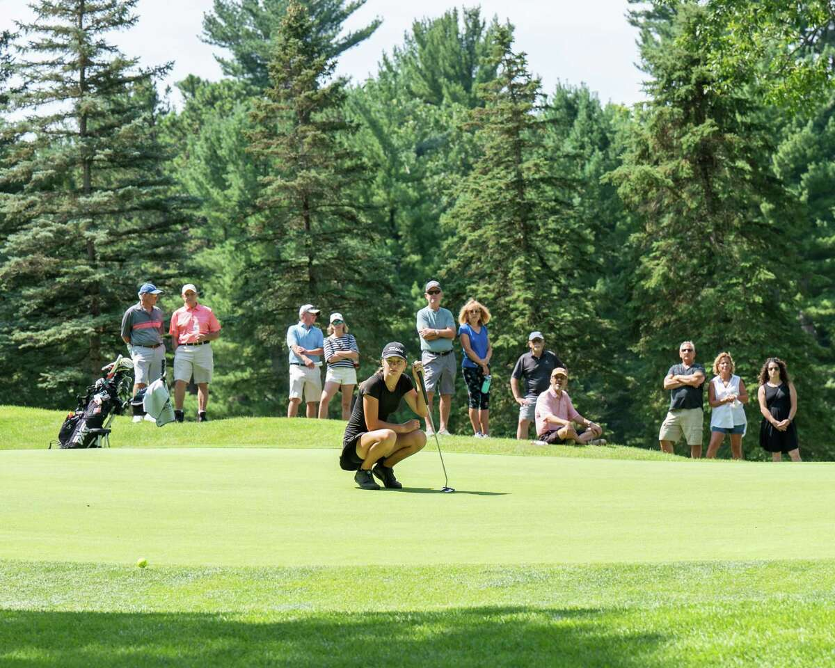 A group of spectators followed Kennedy Swedick, a 14-year-old from Altamont, around Pinehaven Country Club in Guilderland, NY, during round two of the Symetra Tour Twin Bridges Championship on Saturday, July 21, 2021 (Jim Franco/Special to the Times Union)