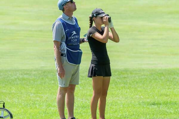 Kennedy Swedick, a 14-year-old from Altamont, and her caddy/coach Anders Mattson figure out what club to hit at Pinehaven Country Club in Guilderland, NY, during round two of the Symetra Tour Twin Bridges Championship on Saturday, July 21, 2021 (Jim Franco/Special to the Times Union)