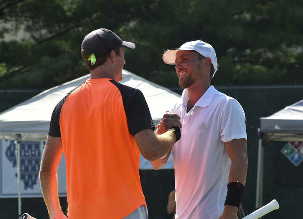 Nathan Ponwith, right, and Reese Stalder congratulate each other after winning the Edwardsville Futures doubles championship on Saturday.
