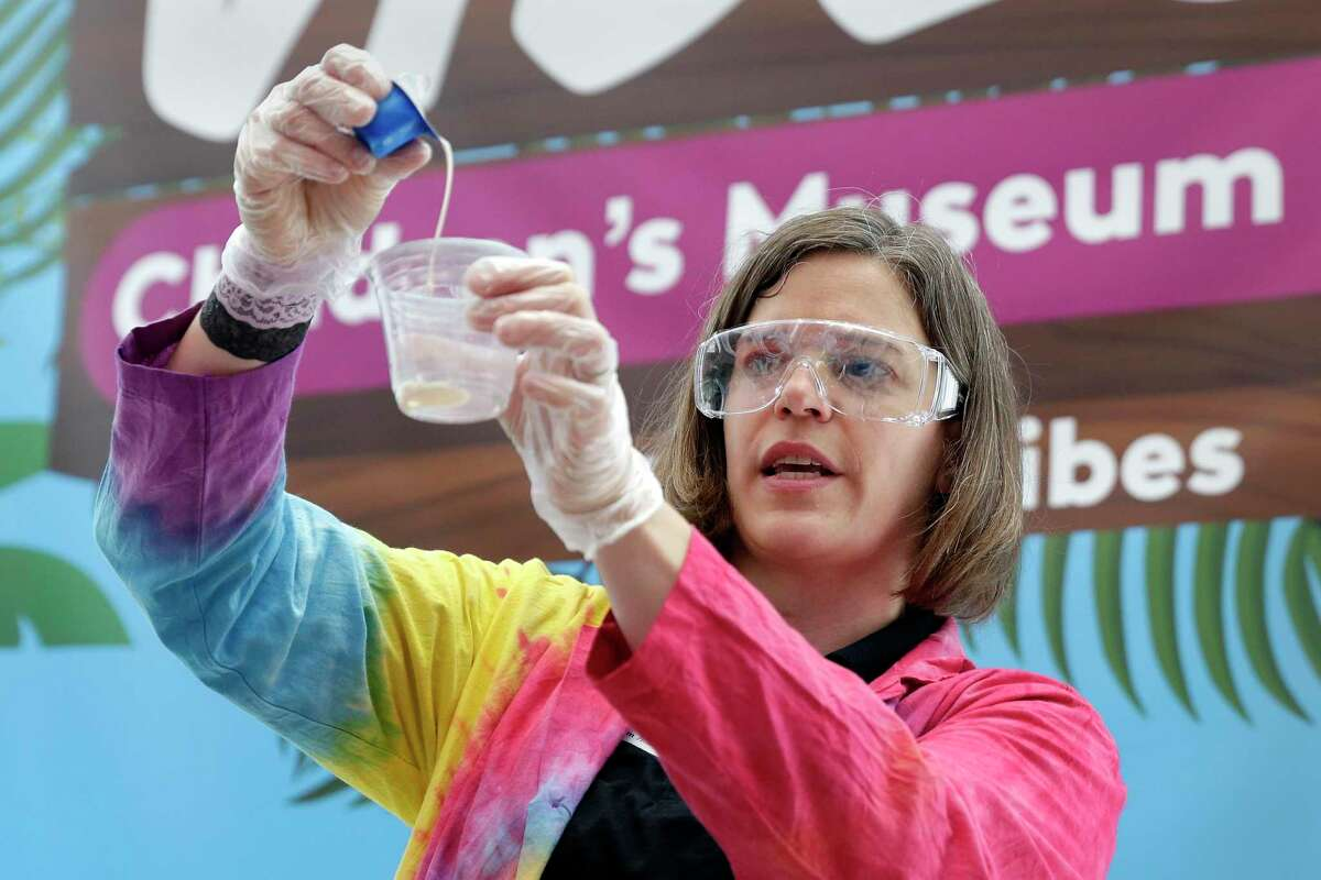 """Danni Dancer, social studies educator, uses coffee creamers to make ice cream during the """"I Scream for Ice Cream"""" food science demonstration, as part of the celebration of National Ice Cream Day at the Children's Museum of Houston Saturday, Jul. 24, 2021 in Houston, TX."""