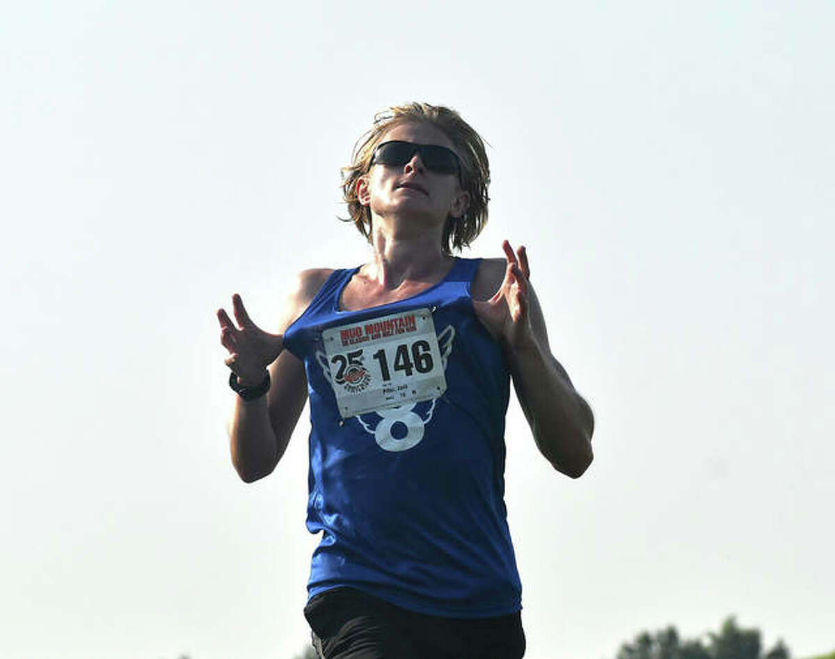 EHS graduate and SLU rising sophomore Jack Pifer celebrates as he crosses the finish line for the victory at Mud Mountain on Saturday at SIUE.