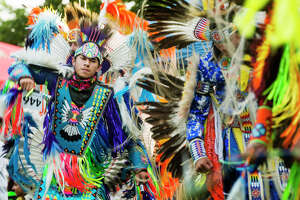 Thousands of people gather to watch the grand entrance during the 37th Annual Saginaw Chippewa Pow Wow Friday, July 23, 2021 at the Saginaw Chippewa Tribal Campground in Mount Pleasant. (Katy Kildee/kkildee@mdn.net)