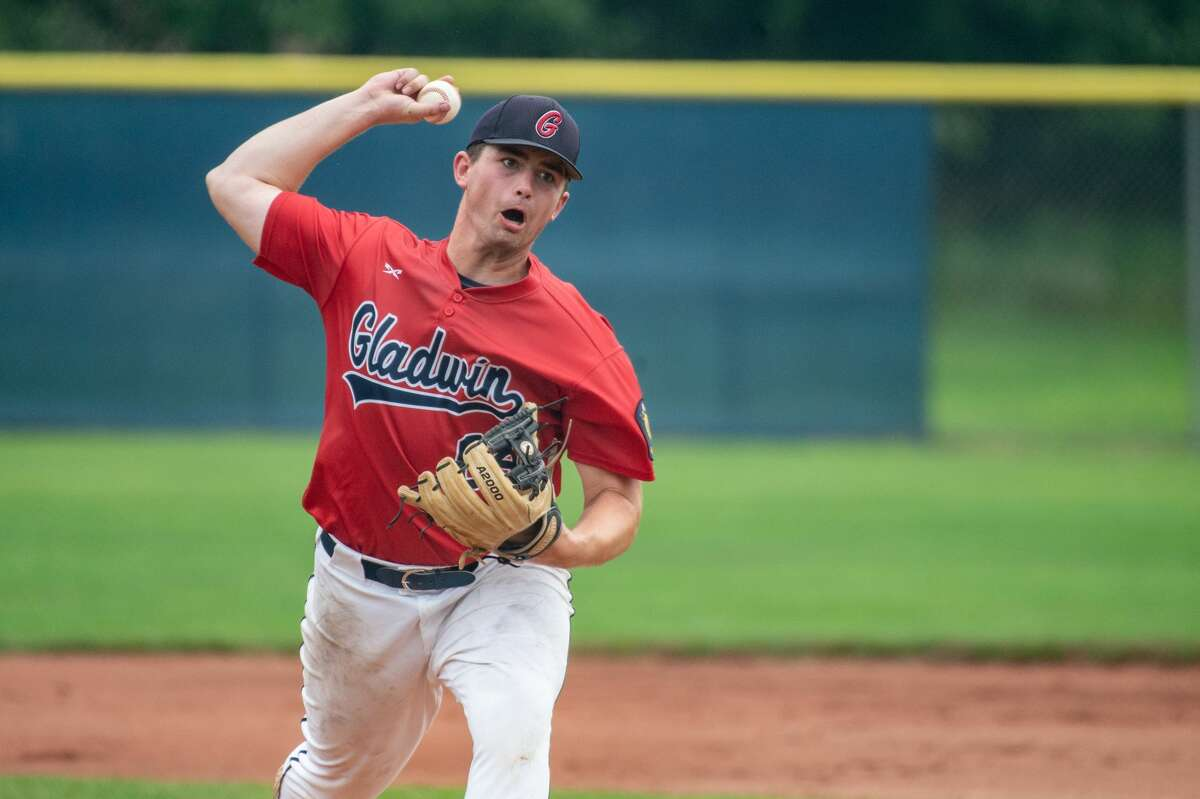 Gladwin Post 171's Owen Franklin throws out a pitch during a game against Berryhill Post 165 Saturday, July 24, 2021 at Northwood University. (Adam Ferman/for the Daily News)