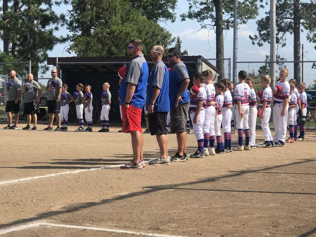 The Northeast Little League minor all-stars stand for the national anthem prior to their game against Schoolcraft on Saturday, July 24, 2021, at the state tournament in Norway. NE finished pool play at 2-1 and will face an opponent to be determined in Monday's quarterfinals.