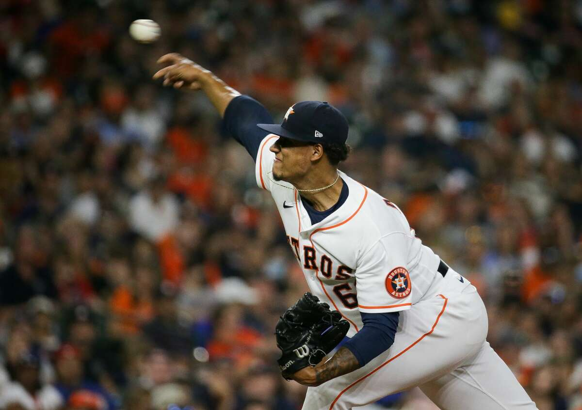 Houston Astros starting pitcher Bryan Abreu (66) throws against the Texas Rangers during the seventh inning of an MLB game at Minute Maid Park on Saturday, July 24, 2021, in Houston.