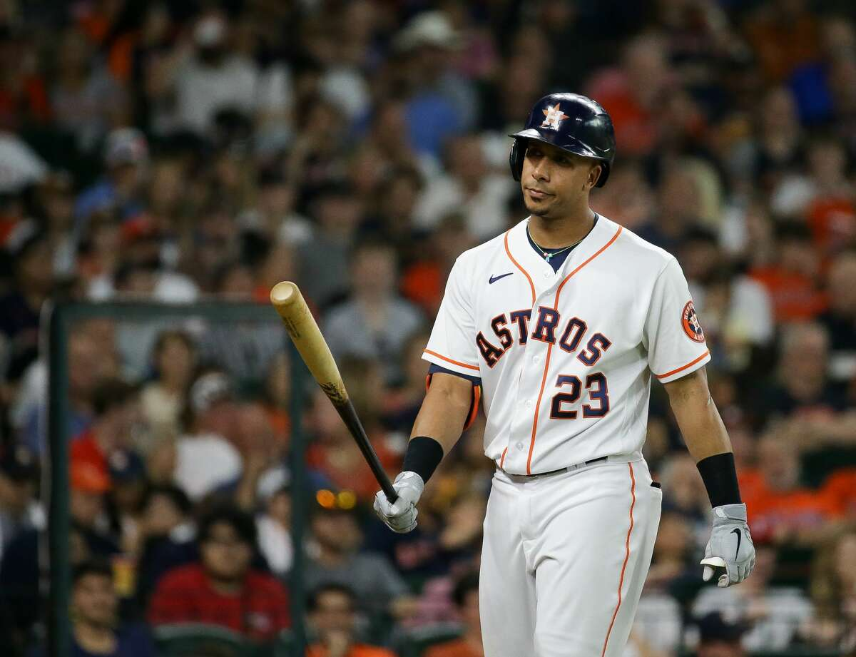 Houston Astros designated hitter Michael Brantley (23) walks to the dugout after striking out against the Texas Rangers during the fifth inning of an MLB game at Minute Maid Park on Saturday, July 24, 2021, in Houston.