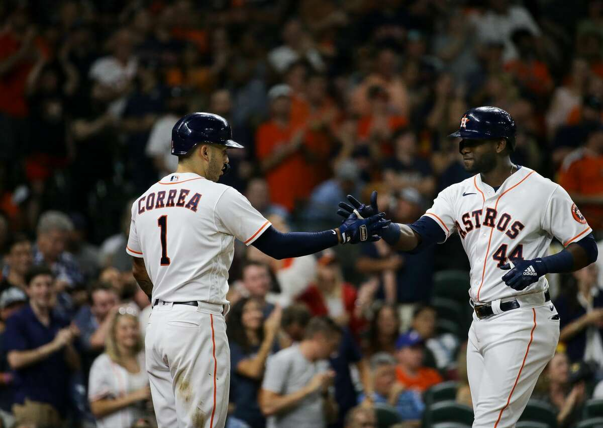 Houston Astros left fielder Yordan Alvarez (44) celebrates with shortstop Carlos Correa (1) after hitting a solo home run against the Texas Rangers during the seventh inning of an MLB game at Minute Maid Park on Saturday, July 24, 2021, in Houston.
