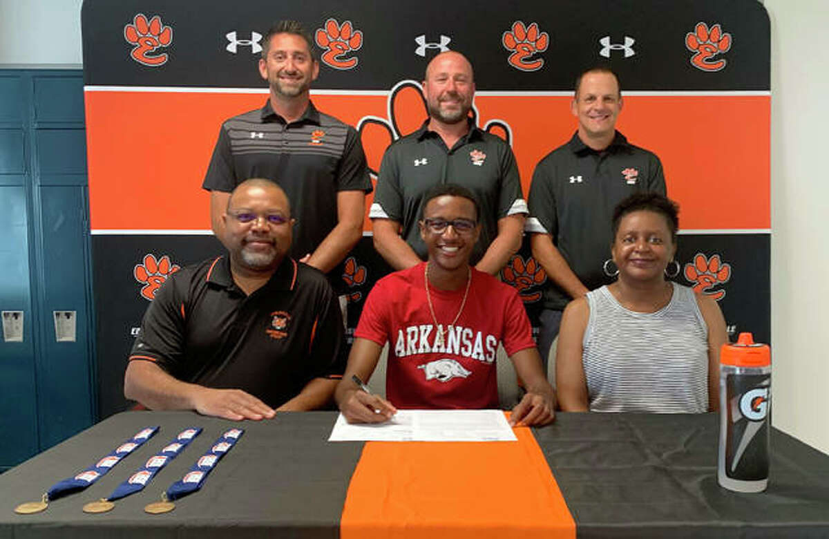 Edwardsville High School graduated senior Brandon Battle, seated center, will run track and field at the University of Arkansas. He is joined in the picture by his parents and EHS assistant coach Alec Holler, EHS track and field coach Chad Lakatos and EHS assistant track coach and cross country coach George Patrylak.