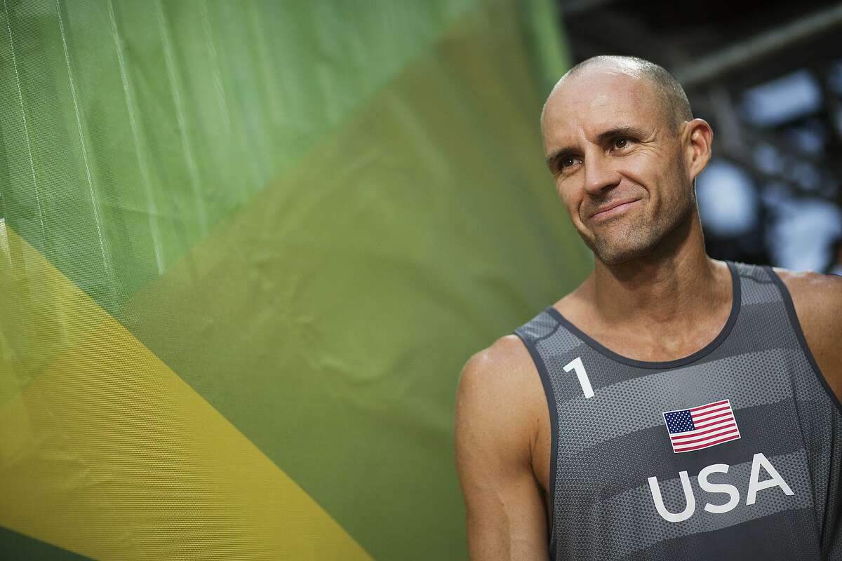 FILE - In this Aug. 8, 2016, file photo, Jake Gibb, of the United States, waits to be introduced to the crowd for a men's beach volleyball match against Austria at the Summer Olympics in Rio de Janeiro, Brazil. American beach volleyball player Taylor Crabb is out of the Olympics after several positive COVID-19 tests, and Tri Bourne will take his place as the partner of four-time Olympian Gibb when the competition begins at Tokyo's Shiokaze Park this weekend. (AP Photo/David Goldman, File)