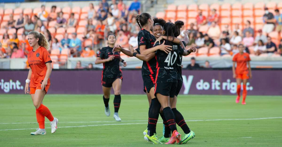 Portland Thorns FC celebrate after scoring during the first half of action between the Houston Dash and the Portland Thorns during a NWSL soccer game at BBVA Compass, Saturday, July 24, 2021, in Houston. Portland Thorns FC leads Houston Dash 1-0. (Juan DeLeon/Contributor)