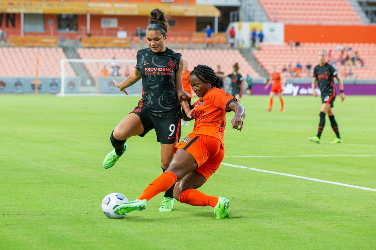 Houston Dash forward Jamia Fields (24) slides to takeaway the ball from Portland Thorns FC forward Sophia Smith (9) during the first half of action between the Houston Dash and the Portland Thorns during a NWSL soccer game at BBVA Compass, Saturday, July 24, 2021, in Houston. Portland Thorns FC defeated Houston Dash 1-0. (Juan DeLeon/Contributor)
