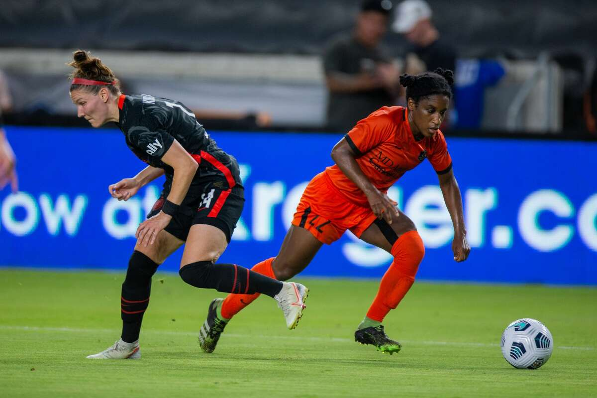 Houston Dash forward jasmine Spencer (22) pushes the ball down the field during the second half of action between the Houston Dash and the Portland Thorns during a NWSL soccer game at BBVA Compass, Saturday, July 24, 2021, in Houston. Portland Thorns FC defeated Houston Dash 1-0. (Juan DeLeon/Contributor)