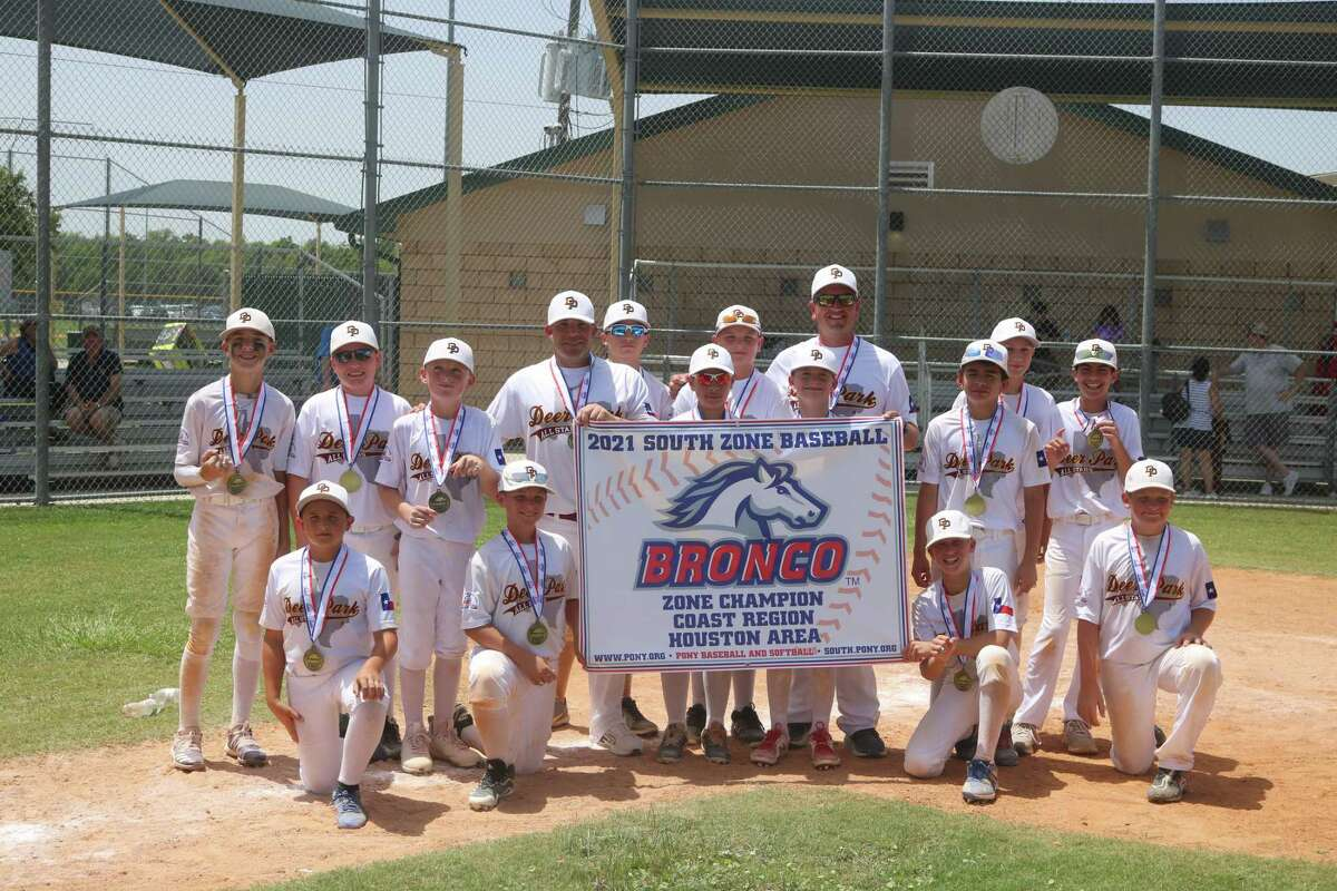 The newly-crowned South Zone champion Deer Park Bronco all-stars show their championship banner to their fans Saturday afternoon, following the team's 6-4 win over the PYBSA all-stars.