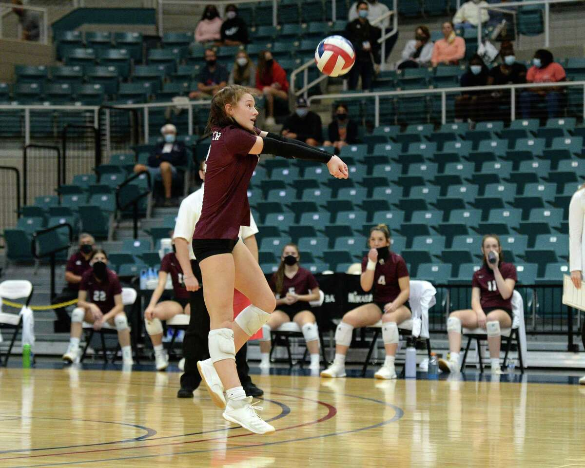 Courtney O'Brien (12) of Cinco Ranch digs for a ball during the first set of a 6A-III regional quarterfinal game between the Cinco Ranch Cougars and the Seven Lakes Spartans on Saturday, November 28, 2020 at Leonard Merrell Center, Katy, TX.