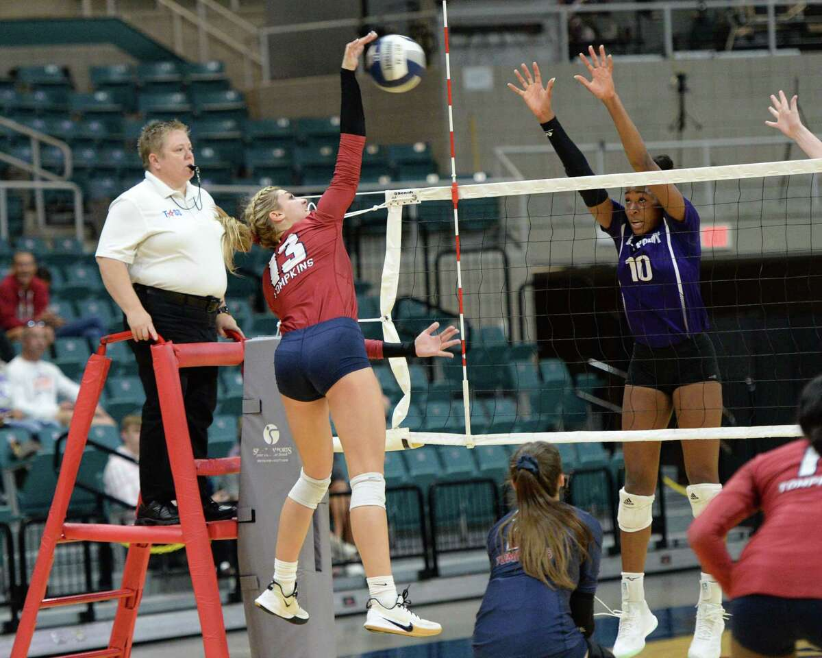 Paris Herrman (13) of Tompkins hits a shot during the first set of a Class 6A Region III bi-district volleyball playoff match between the Tompkins Falcons and the Ridge Point Panthers on Tuesday, November 5, 2019 at the Leonard Merrell Center, Katy, TX.