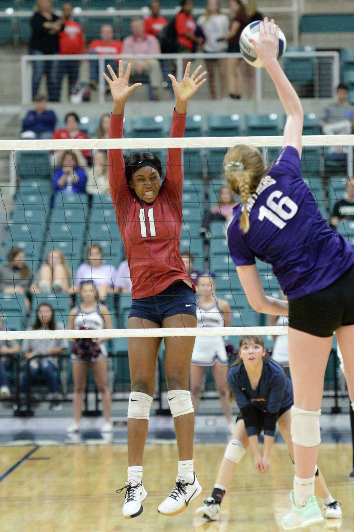 Cindy Tchouangwa (11) of Tompkins goes up for an attempted block during the second set of a Class 6A Region III bi-district volleyball playoff match between the Tompkins Falcons and the Ridge Point Panthers on Tuesday, November 5, 2019 at the Leonard Merrell Center, Katy, TX.