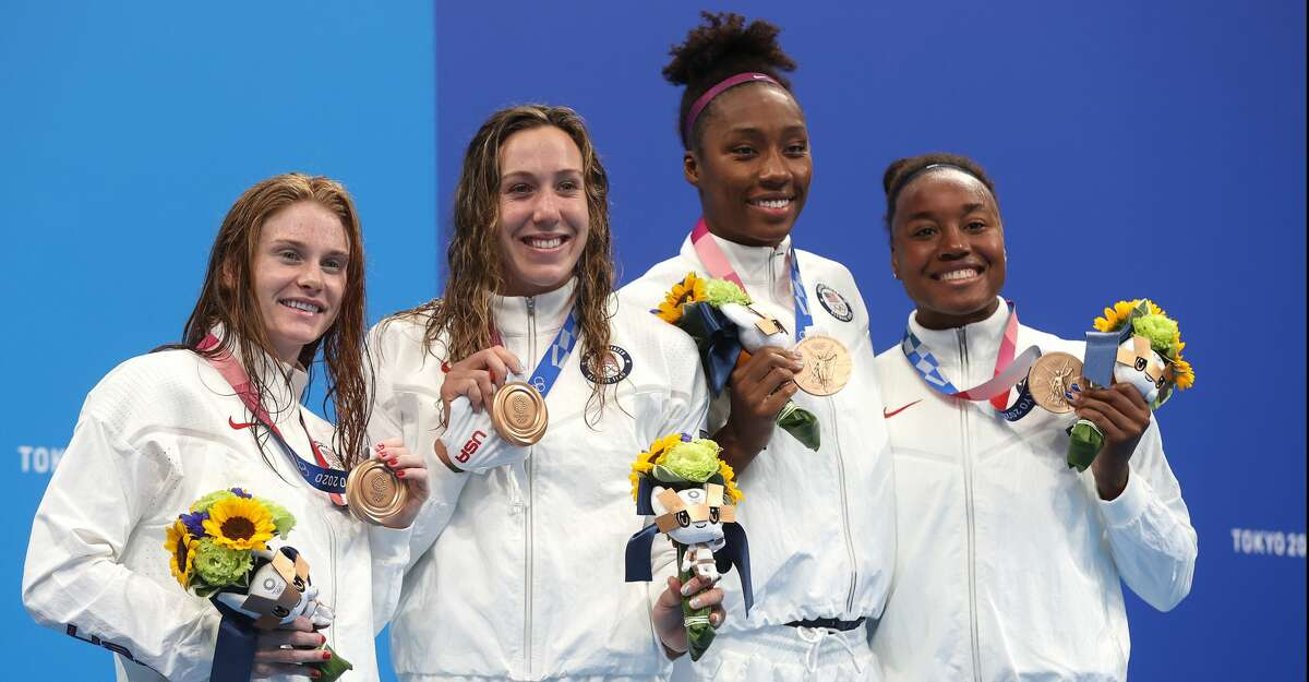 Erika Brown, Abbey Weitzeil, Natalie Hinds and Simone Manuel of Team United States pose with the bronze medal for the Women's 4 x 100m Freestyle Relay Final on day two of the Tokyo 2020 Olympic Games at Tokyo Aquatics Centre on July 25, 2021 in Tokyo, Japan. (Photo by Clive Rose/Getty Images)