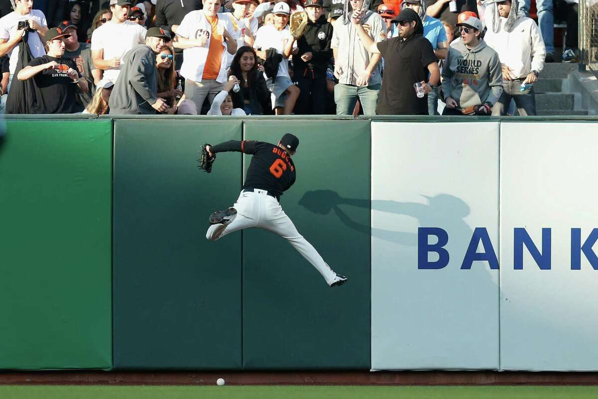SAN FRANCISCO, CALIFORNIA - JULY 24: Steven Duggar #6 of the San Francisco Giants is unable to catch a fly ball \ at Oracle Park on July 24, 2021 in San Francisco, California. (Photo by Lachlan Cunningham/Getty Images)
