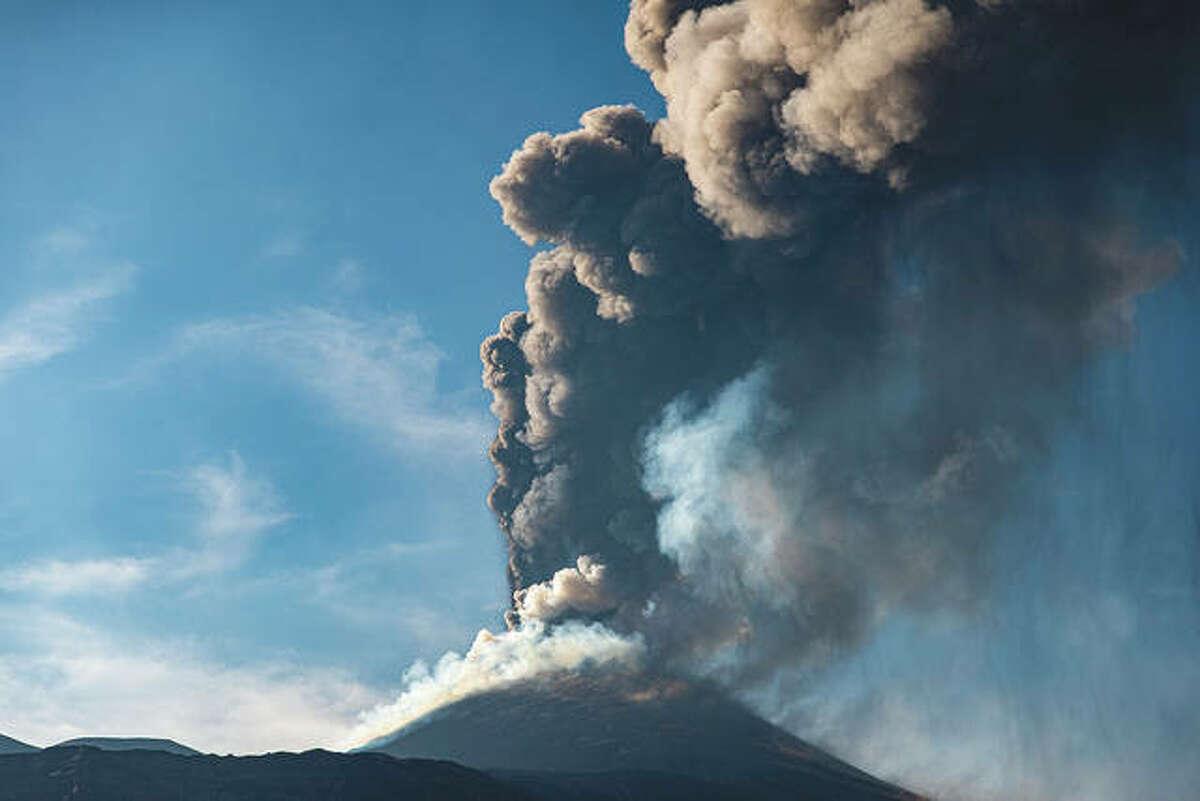 An ash column rises during an eruption of Mount Etna, Europe's largest active volcano. Since Feb. 16, Mouny Etna has begun a series of eruptive episodes.
