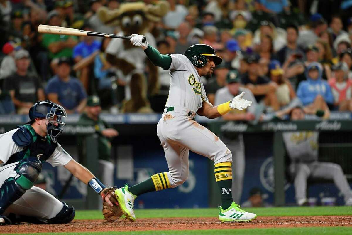 SEATTLE, WASHINGTON - JULY 24: Tony Kemp #5 of the Oakland Athletics hits the ball during the seventh inning of the game against the Seattle Mariners at T-Mobile Park on July 24, 2021 in Seattle, Washington. (Photo by Alika Jenner/Getty Images)