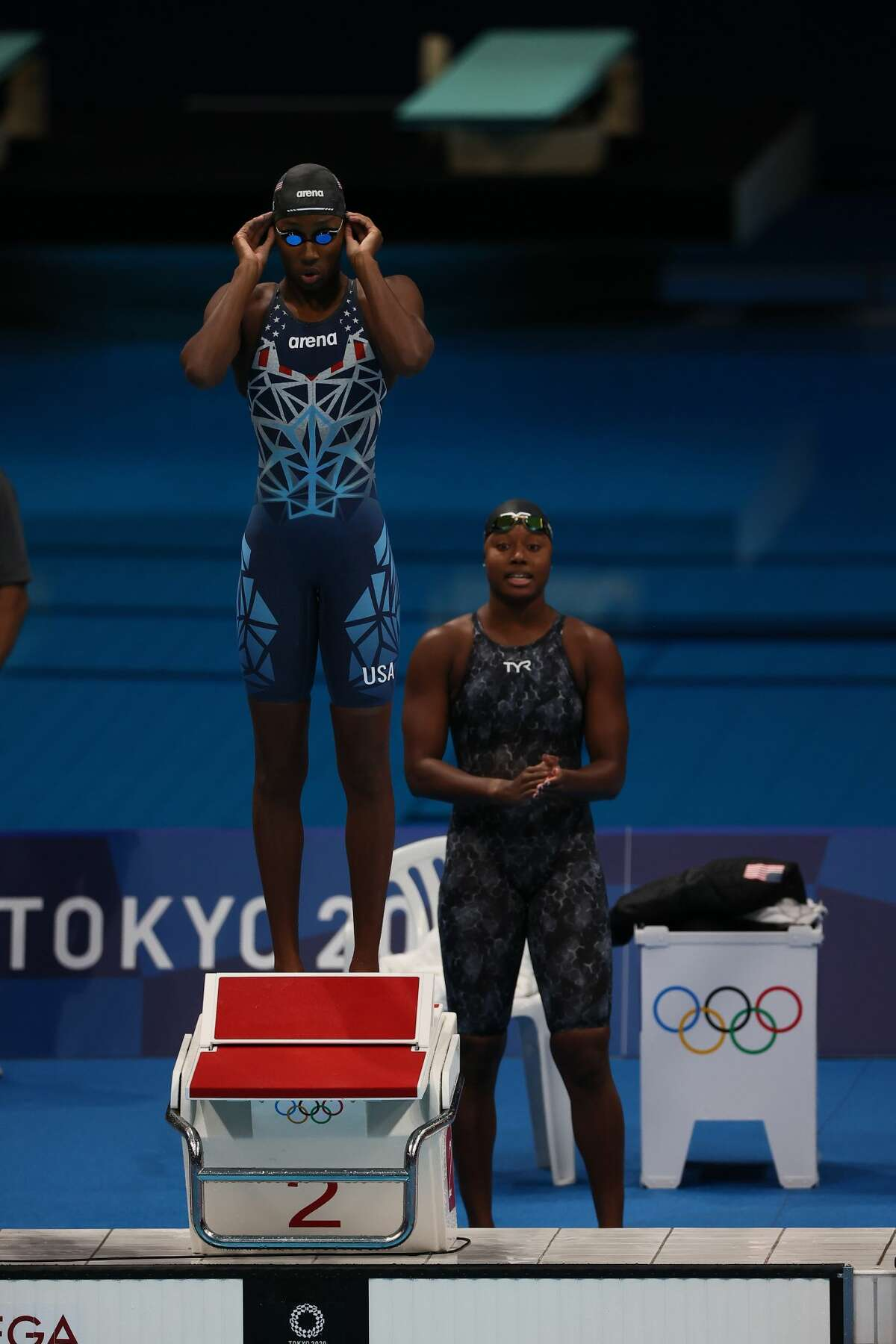 TOKYO, JAPAN - JULY 25: Natalie Hinds and Simone Manuel of Team United States look on during the Women's 4 x 100m Freestyle Relay Final on day two of the Tokyo 2020 Olympic Games at Tokyo Aquatics Centre on July 25, 2021 in Tokyo, Japan. (Photo by Tom Pennington/Getty Images)