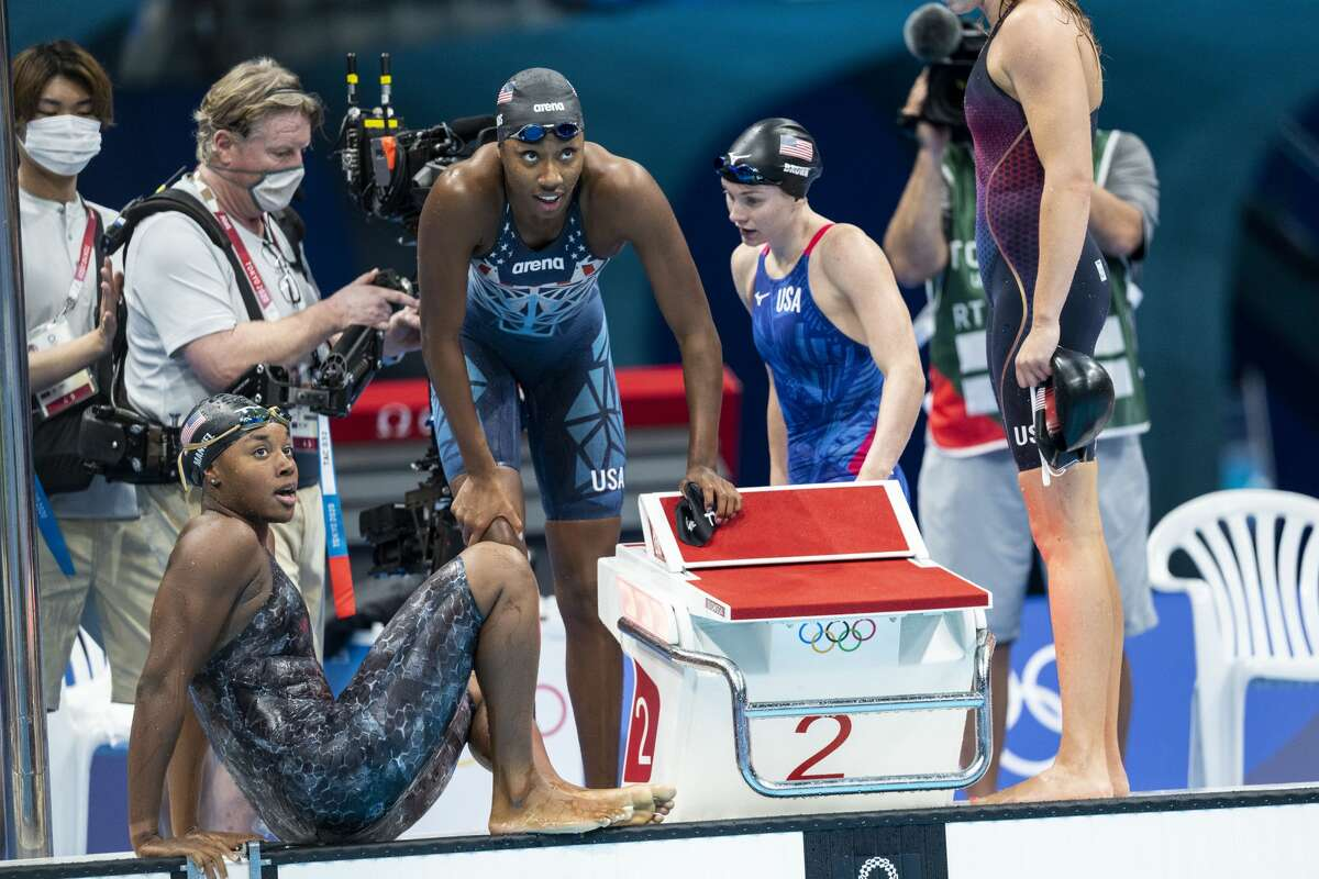 Simone Manuel and Natalie Hinds of the U.S. react after winning bronze in the womenÃ?•s 4 x 100 meter freestyle finals during the 2020 Tokyo Olympics, at the Tokyo Aquatics Center, Sunday, July 25, 2021. Australia won the gold. (Doug Mills/The New York Times)
