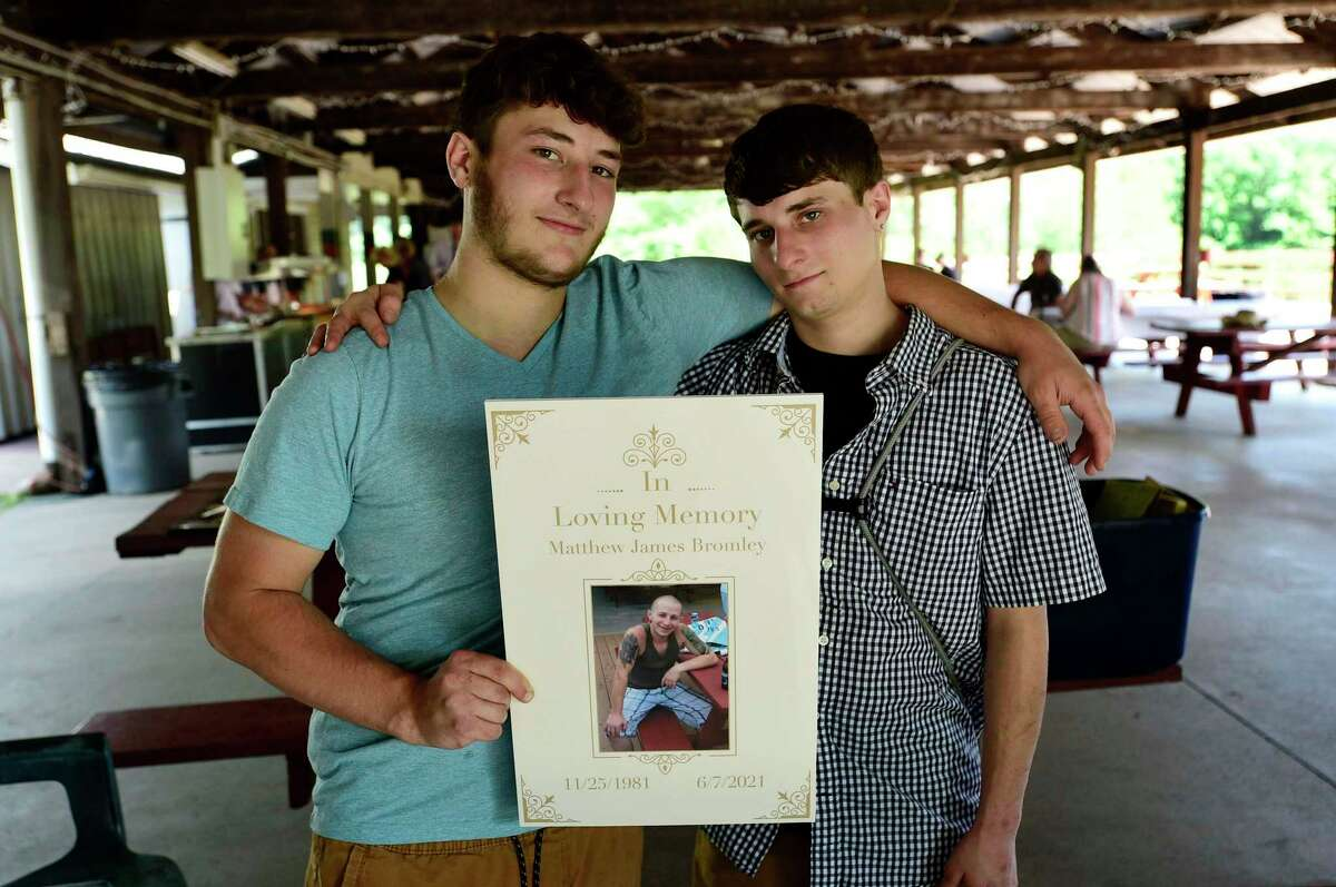 Zack and Andrew Bromley attend a celebration of life for their dad, former Torrington resident Matthew Bromley, Saturday, July 24, 2021, at Elks Pond in Torrington, Conn. Bromley was fatally shot in the head outside the Litchfield law firm Cramer & Anderson last month. At the celebration friends and family remembered Bromley's life by sharing photographs.