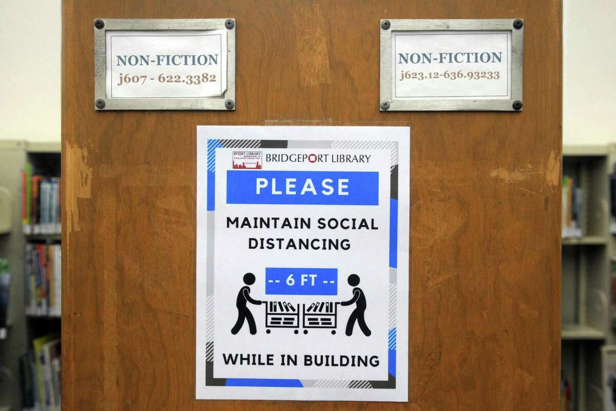 Safety and social distancing reminders in place in the Burroughs-Saden branch library in downtown Bridgeport.