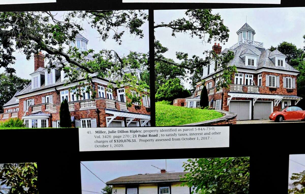 The mansion at 21 Point Road on Wilson Point is listed on the delinquent tax board at city hall and whose owners owe over $300,000 dollars Friday, July 23, 2021, in Norwalk, Conn. There will be a tax auction in September for owners do not pay.