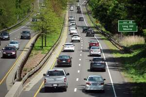 Traffic moves steadily along the Merritt Parkway, in Trumbull, Conn. May 12, 2021.