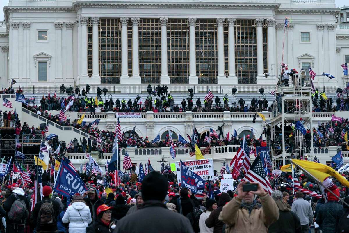 In this Jan. 6, 2021 file photo, violent insurrectionists loyal to President Donald Trump storm the U.S. Capitol in Washington. (AP Photo/Jose Luis Magana, File)