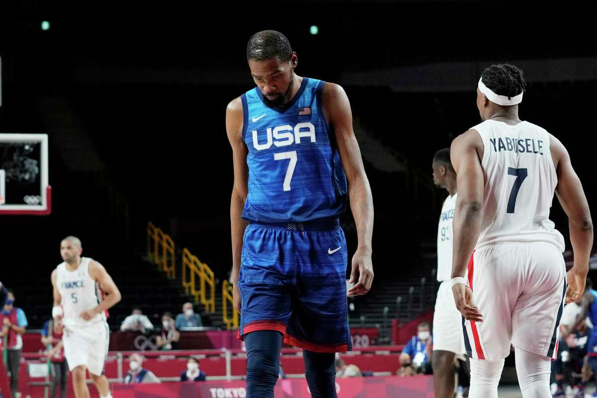 United States' forward Kevin Durant (7) walks up the court during a men's basketball loss to France in a preliminary round game at the 2020 Summer Olympics, Sunday, July 25, 2021, in Saitama, Japan.