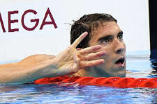 Michael Phelps puts up four fingers after winning his fourth Gold medal during the Olympic Games in Rio De Janeiro on Aug. 11, 2016.