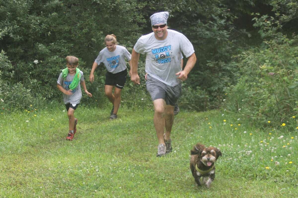 Nearly 200 people came out to run in West Shore Community College's Muddy Fox Trot 5K on Saturday. The boot camp-style obstacle course spread throughout the campus and proceeds go to the WSCC Foundation student scholarship fund.