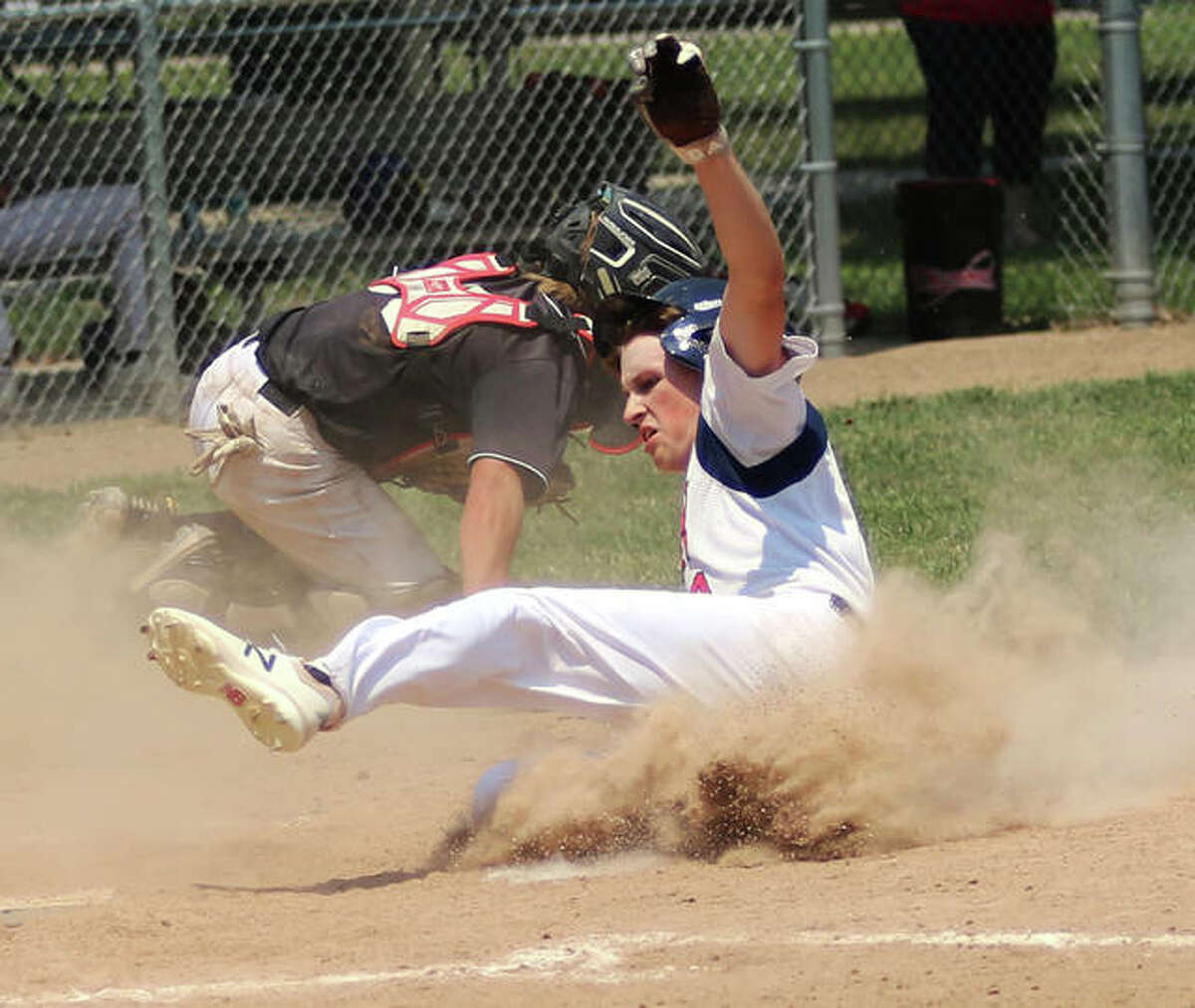 Brendon Smith of Alton Post 126 (right) had a pair of hits, including a home run, three RBIs and a pair of runs scored in Saturday's 10-9 loss to rival Highland in a losers bracket game in the Fifth Division Tournament in Centralia. He is shown sliding in with a run as Highland's catcher fields a wide throw in Alton's victory over Highland earlier this season victory in the championship game of the Firecracker Tournament.