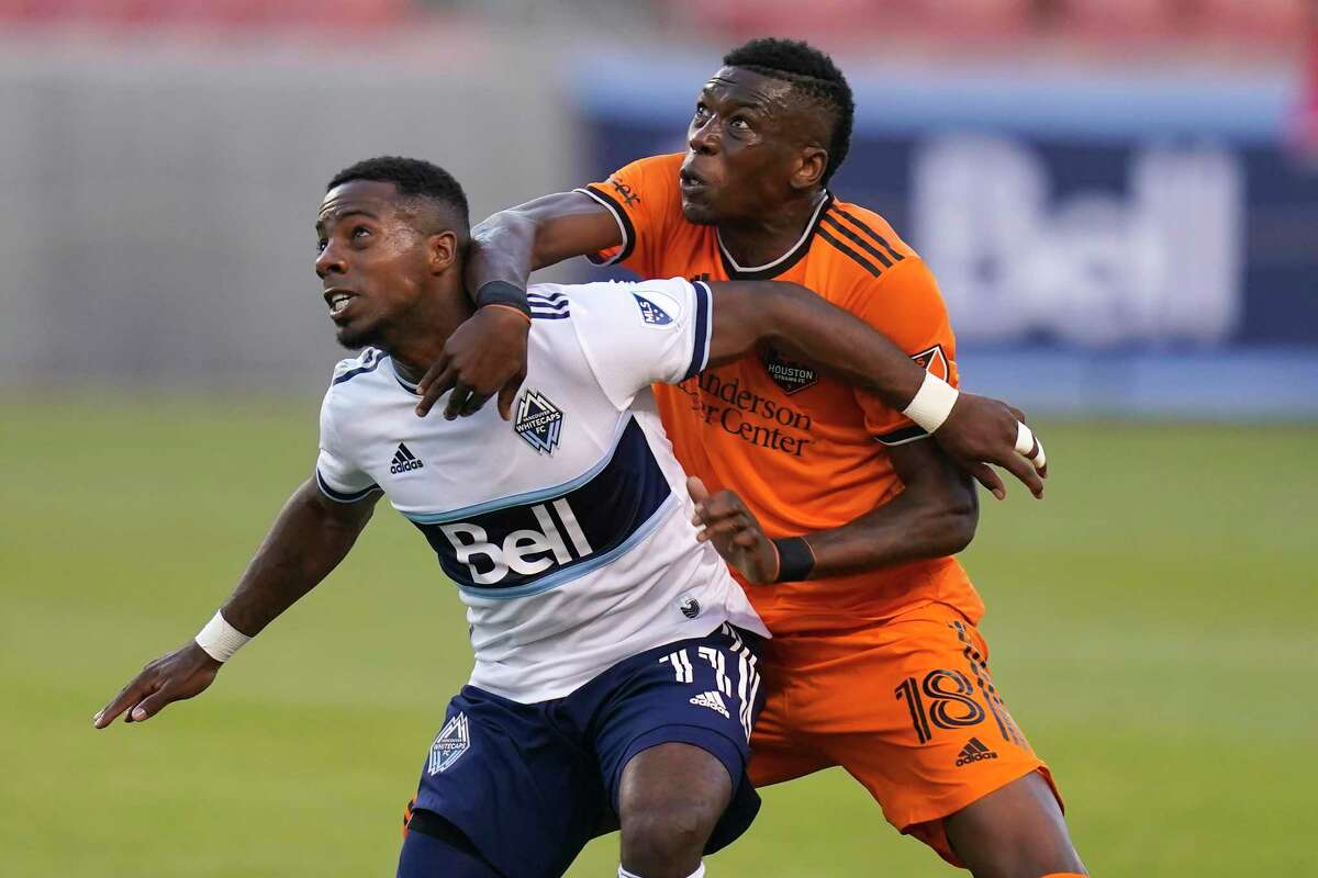 The addition of Teenage Hadebe, fighting for position with Vancouver's Cristian Dajome, has helped Houston's defense.