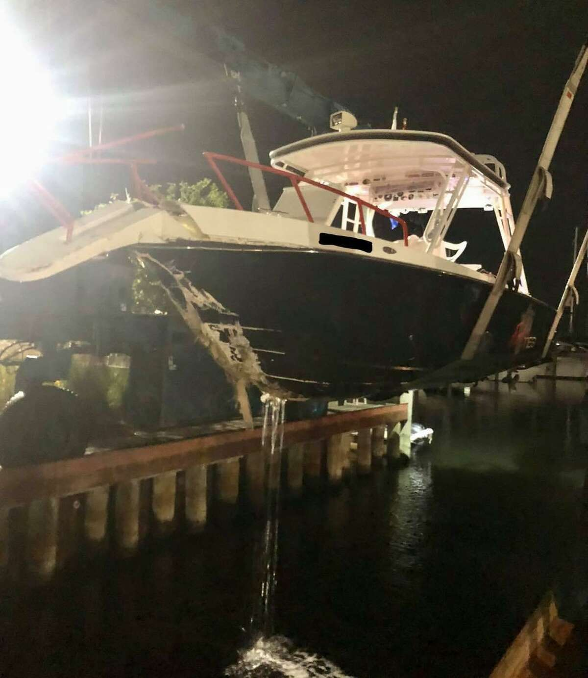 The boat crashed into the break wall Saturday night resulting in several injuries.
