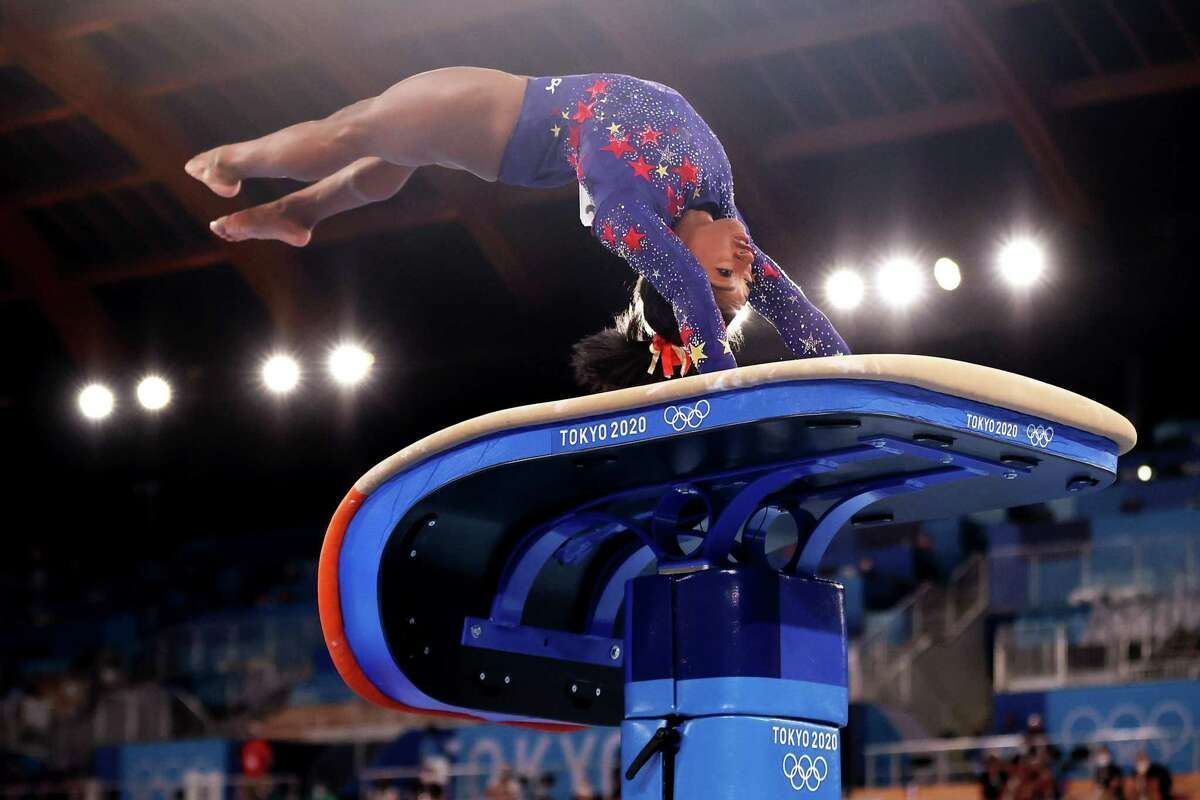 TOKYO, JAPAN - JULY 25: Simone Biles of Team United States competes on vault during Women's Qualification on day two of the Tokyo 2020 Olympic Games at Ariake Gymnastics Centre on July 25, 2021 in Tokyo, Japan. (Photo by Laurence Griffiths/Getty Images)