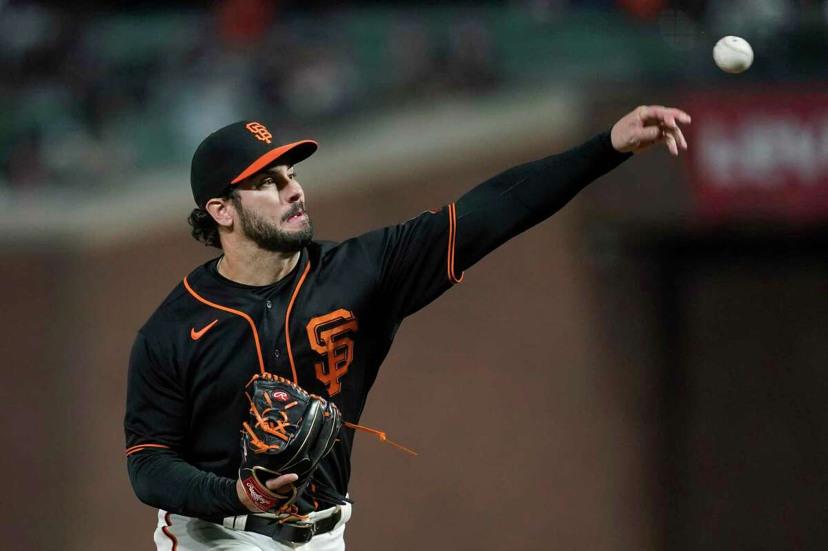 San Francisco Giants' Mike Tauchman pitches to a Pittsburgh Pirates batter during the ninth inning of a baseball game in San Francisco, Saturday, July 24, 2021. (AP Photo/Jeff Chiu)