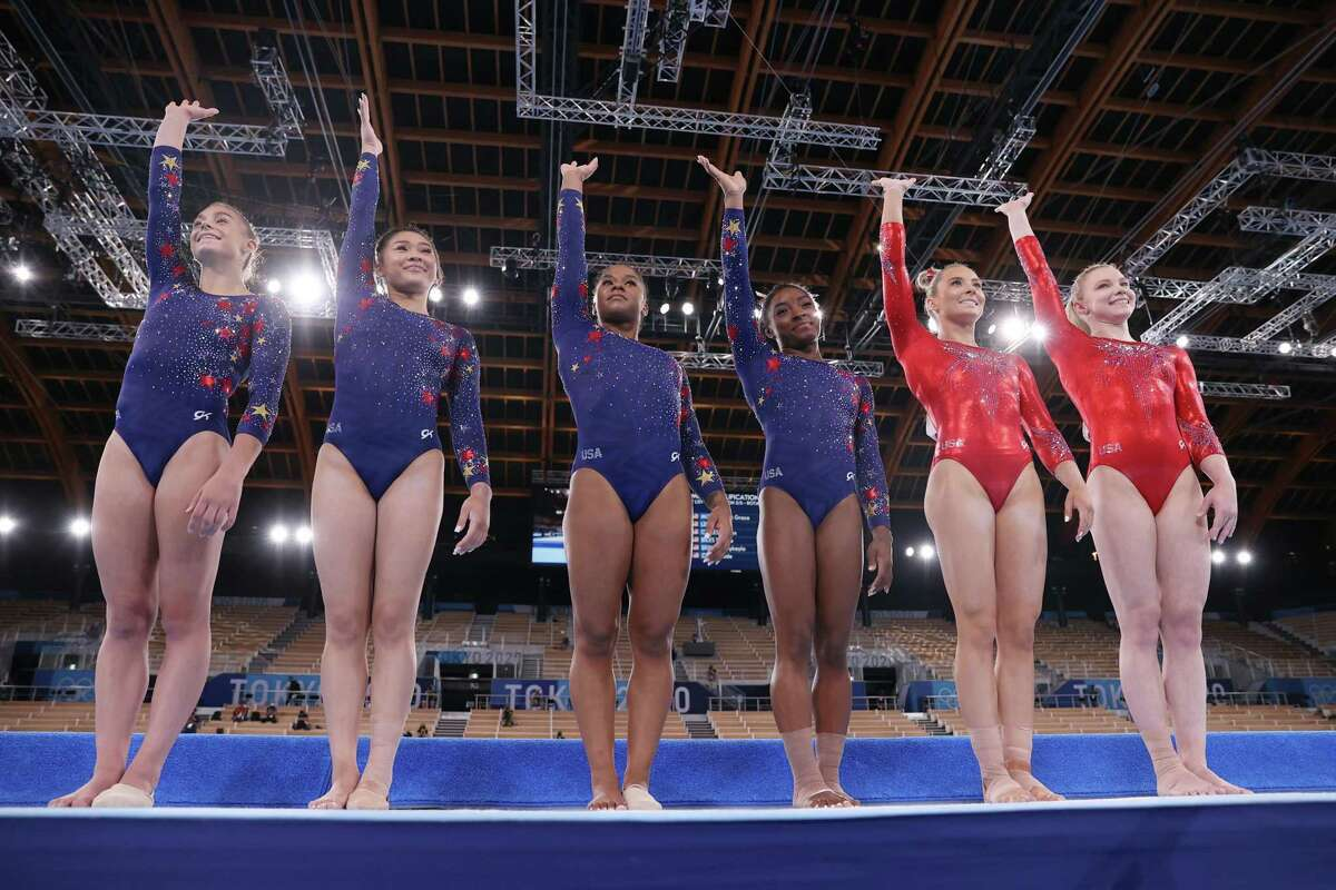 TOKYO, JAPAN - JULY 25: Grace McCullum, Sunisa Lee, Jordan Chiles, Simone Biles, Mykayla Skinner and Jade Carey of Team USA wave as they line up ahead of their floor routines on day two of the Tokyo 2020 Olympic Games at Ariake Gymnastics Centre on July 25, 2021 in Tokyo, Japan. (Photo by Laurence Griffiths/Getty Images)