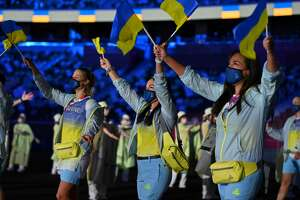 Members of Ukraine delegation parade during the opening ceremony of the Tokyo 2020 Olympic Games, at the Olympic Stadium on July 23, 2021.