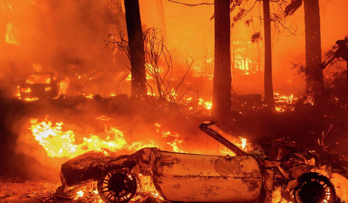 Flames consume vehicles as the Dixie Fire tears through Indian Falls community (Plumas County).