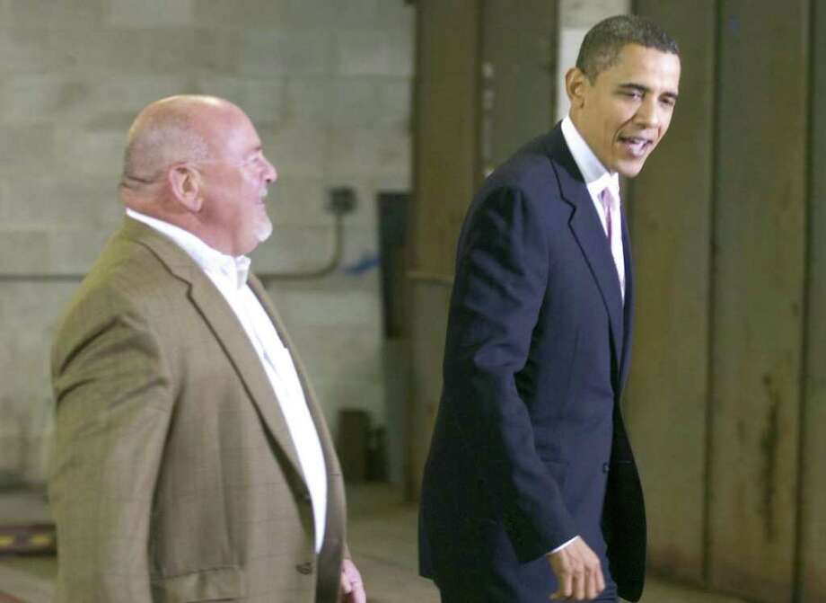 President Barack Obama meets with Bruce T. Moore, Sr., of Eastern Land Managment, Inc. in Stamford prior to a fundraiser for U.S. Sen. Christopher Dodd on Oct. 23, 2009. (AP Photo/The Advocate/Chris Preovolos, pool) Photo: File Photo / Stamford Advocate File Photo