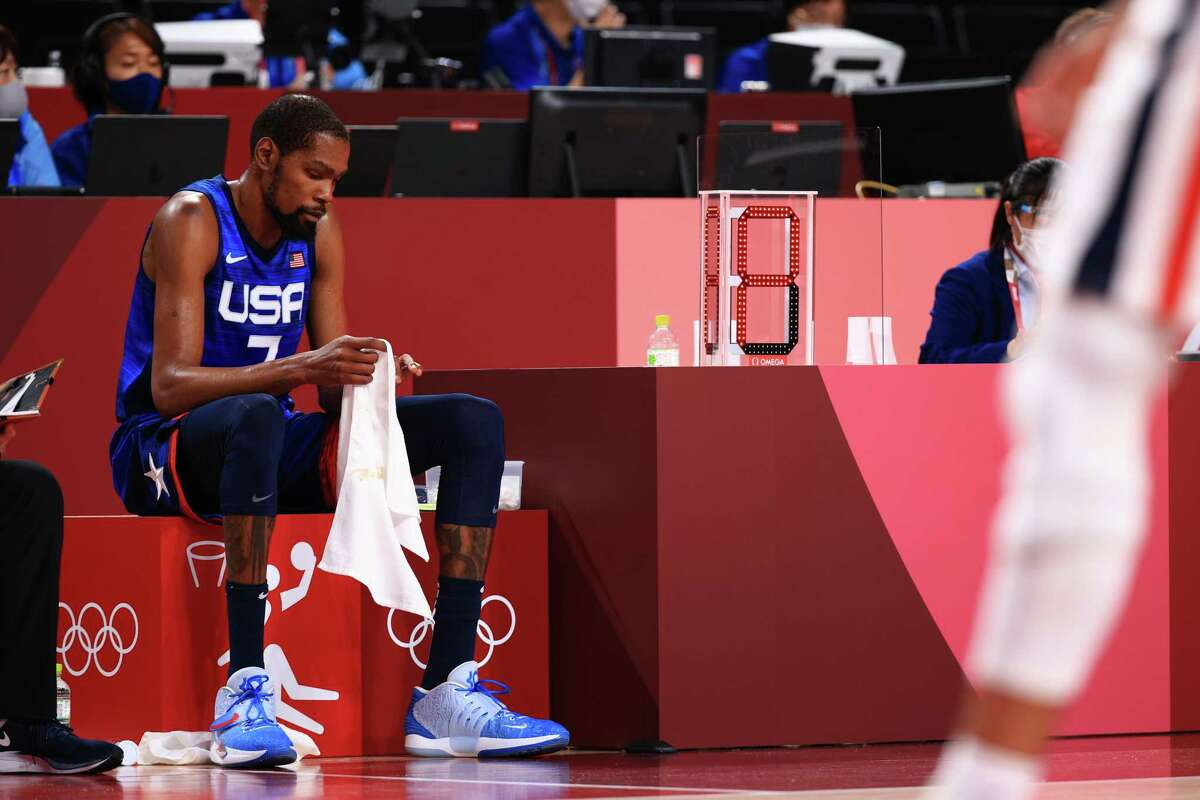 SAITAMA, JAPAN - JULY 25: Kevin Durant #7 of Team United States sits on the bench in disappointment as time winds down in the United States' loss to France in the Men's Preliminary Round Group B game on day two of the Tokyo 2020 Olympic Games at Saitama Super Arena on July 25, 2021 in Saitama, Japan. (Photo by Mike Ehrmann/Getty Images)