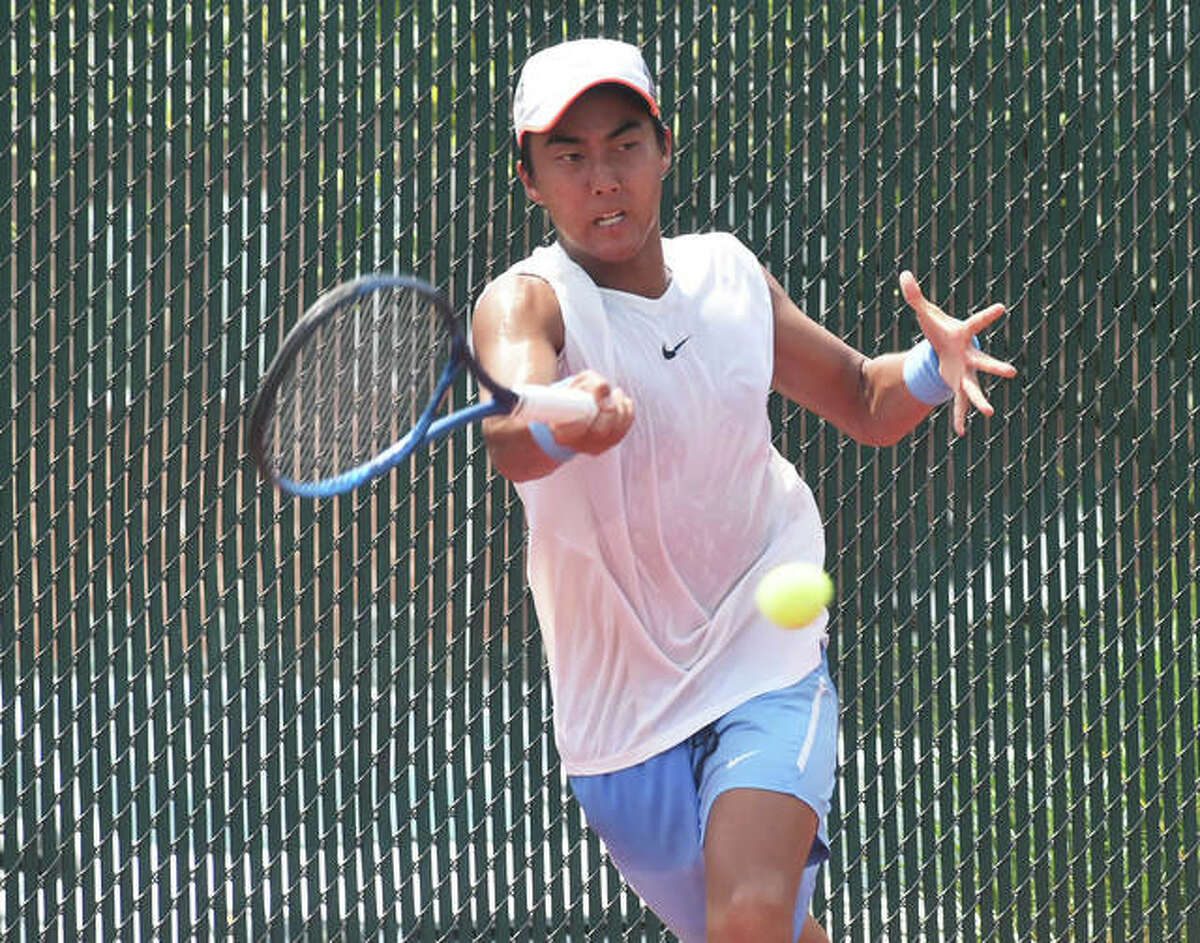 Rinky Hijikata connects on a forehand shot to clinch the championship match against Strong Kirchheimer on Sunday.