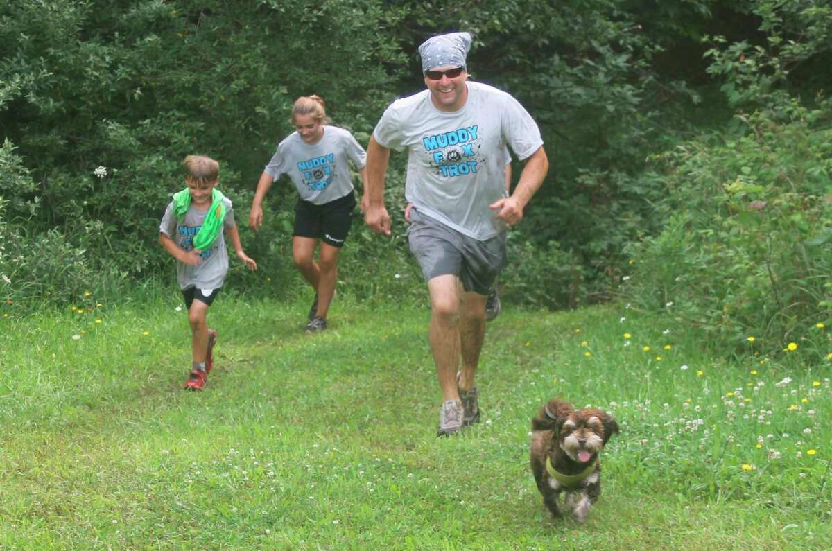 Men, women, children and even dogsnavigated the 13 obstacles on theWest Shore Community Collegecampus Saturday during the college's Muddy Fox Trot 5Krun. (Kyle Kotecki/News Advocate)