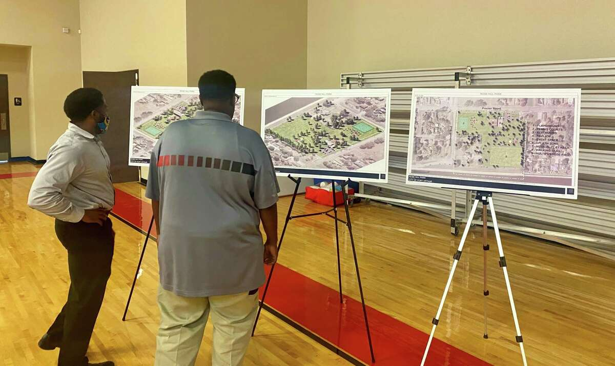 Port Arthur residents look over renderings for the improvements to Ross Hill Park during an open forum on Thursday night.